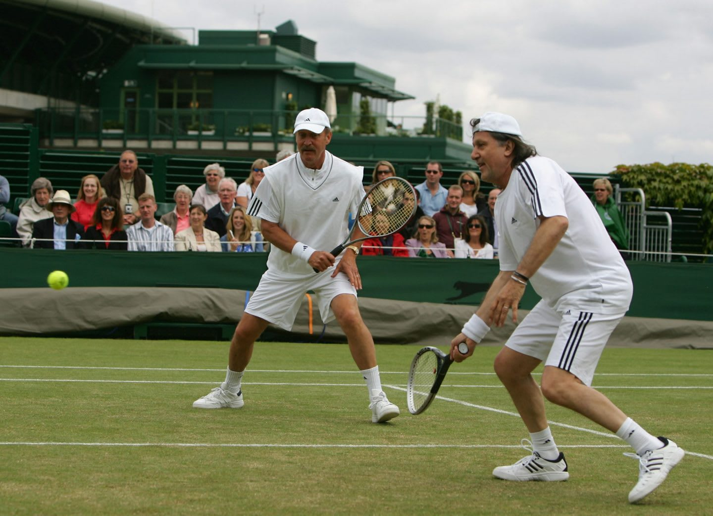 Two men playing a doubles game in tennis on a court, Stan Smith, Ilie Nastase, tennis, athlete, athletes, sports, sport, London,