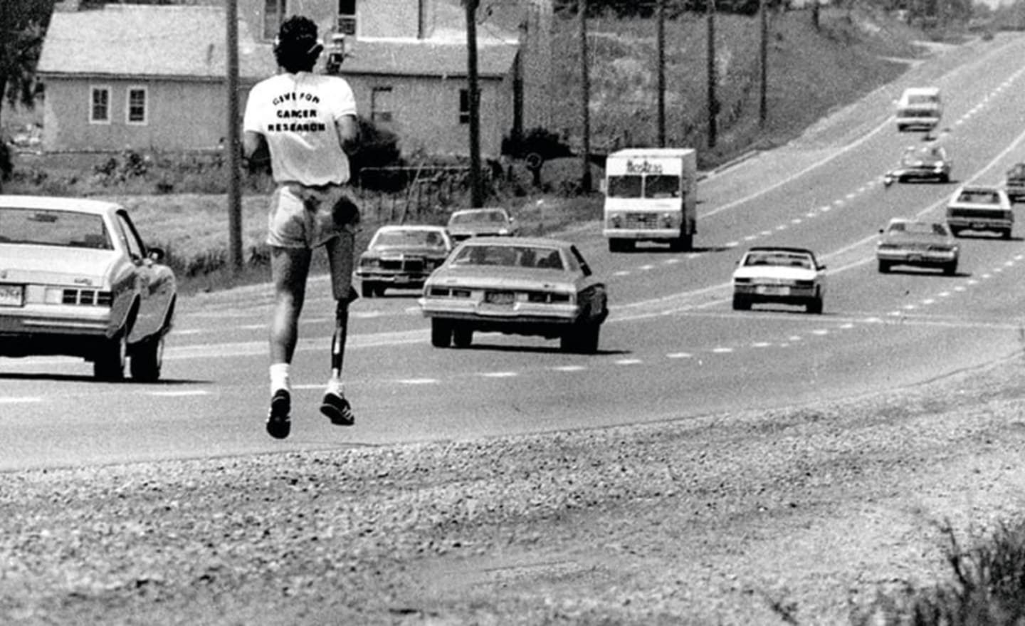 Black and white image of man with prosthetic leg running on road, Terry Fox, Canada, athlete, motivation, inspiration