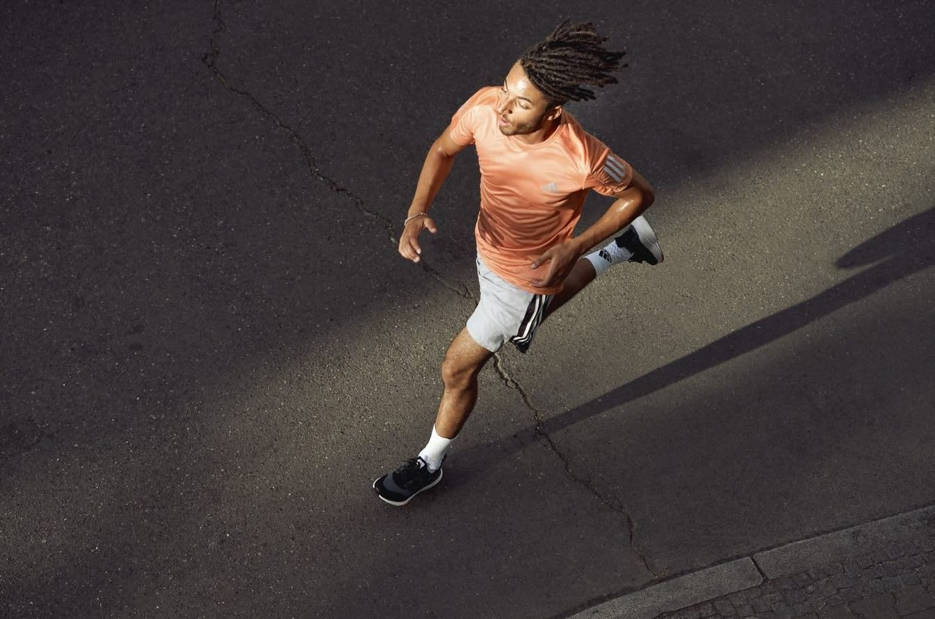 Man wearing orange sports shirt running on street, adidas, running, sports, sport, fitness