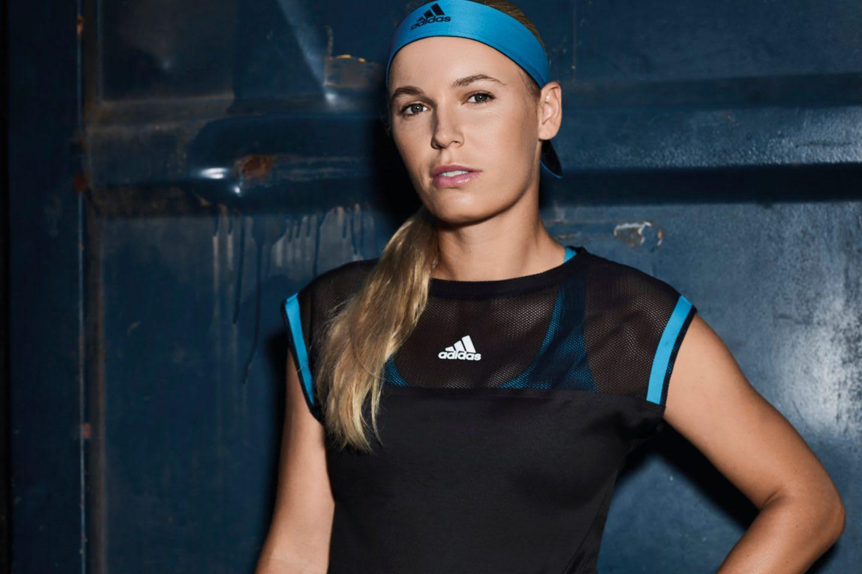 Woman wearing blue and black adidas tennis outfit posing, Caroline Wozniacki, tennis, player, Danish, athlete, adidas