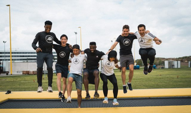 Men and women jumping on yellow trampoline together, adidas Runners, running, captains, adidas, HQ, Herzogenaurach, Germany, campus