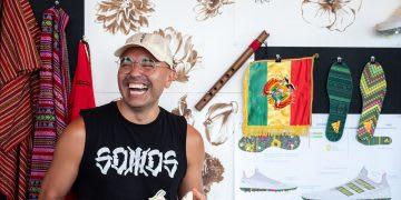Man wearing a black tank top smiling while holding shoe design, Julia Aleman, adidas, employee, designer, HHM, Hispanic