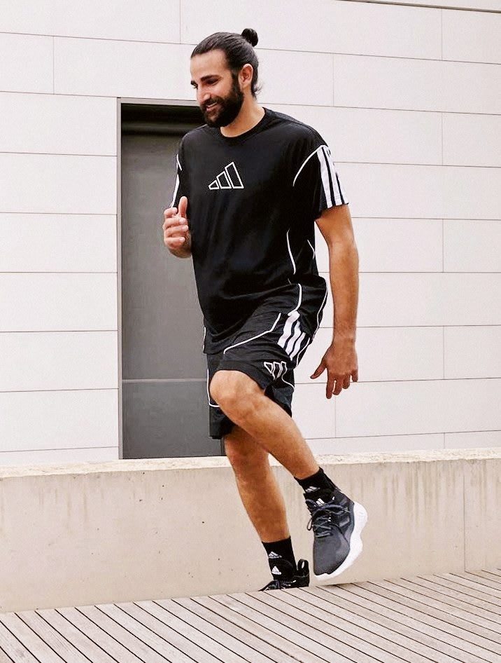 Man wearing black and white sports outfit running, Ricky Rubio, basketball, adidas, sports, exercise