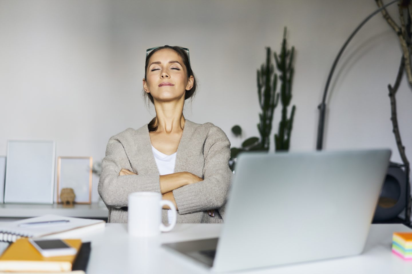 Young woman at home with laptop on desk having a break, work, breathing, stress