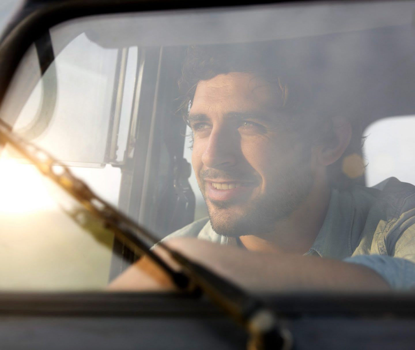 Picture of man smiling while driving through windshield, man, smiling, drive, car