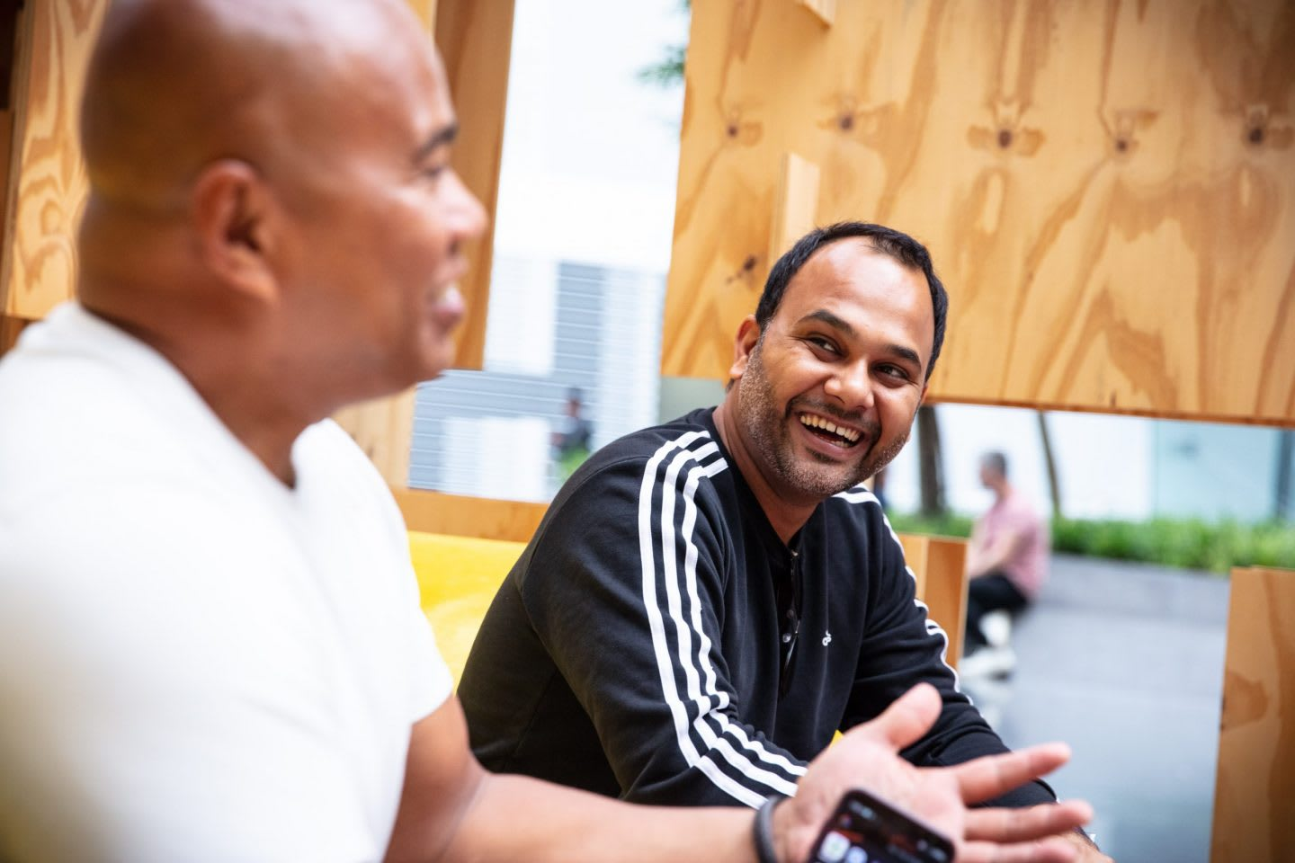 Man wearing black adidas sweatshirt talking and smiling with man in a white t-shirt, adidas, employees, workplace, culture, Herzogenaurach, HQ