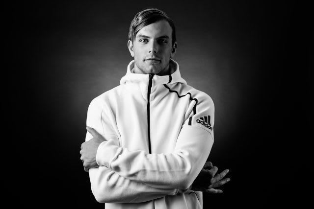 Man with folded arms in white hoodie kyle chalmers olympic champion