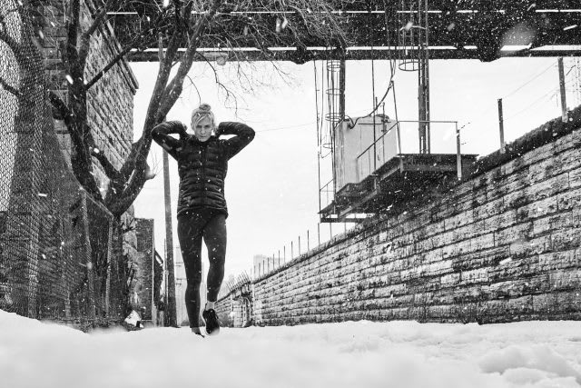 woman running in snow fitness survival guide for the holidays