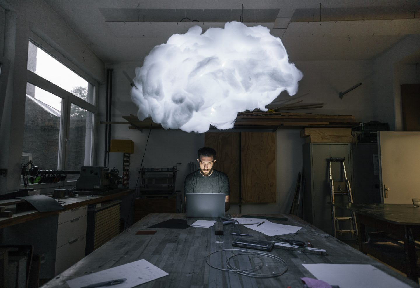 man working with cloud over his head hacking your way to innovation