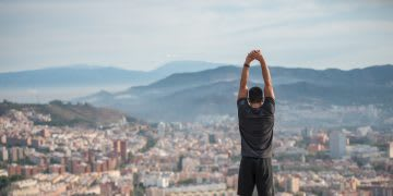 man stretching on a hill smart ways to reach your goal. growth mindset, goalsetting, Gameplan A, Adidas
