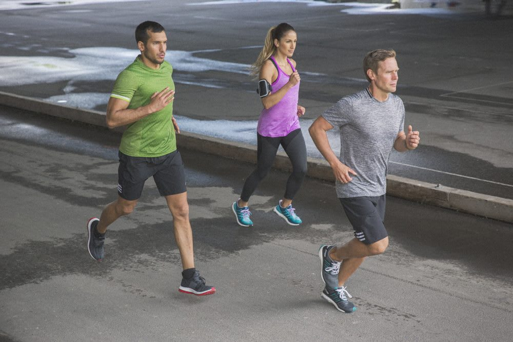 three runners on the street setting goals exercise with like-minded people