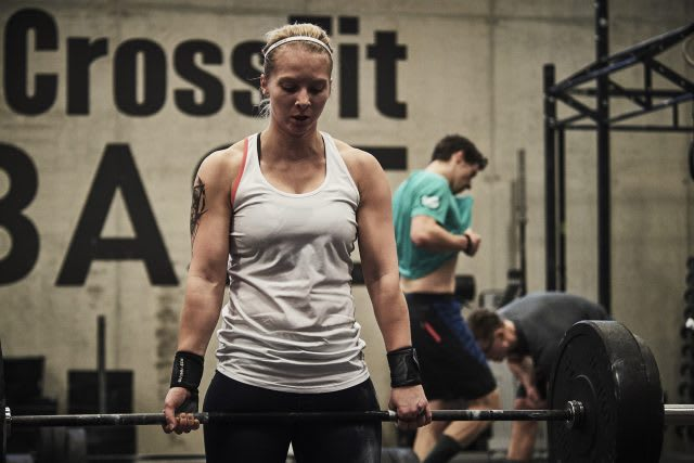 CrossFit woman liftung a barbell muscles training letter to my haters social media own body