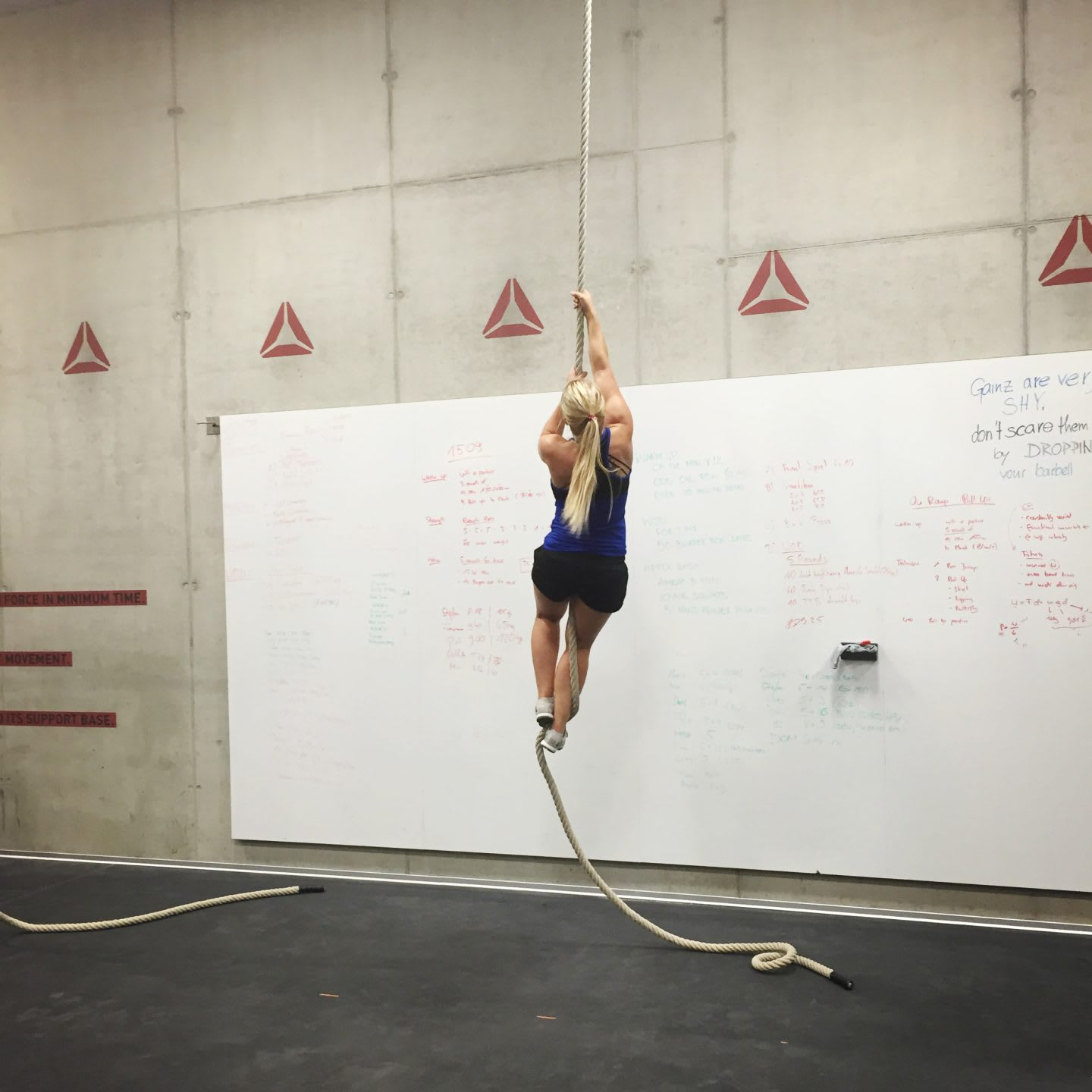 CrossFit girl climbing rope in CrossFit box tough fitness self-confidence letter to my haters