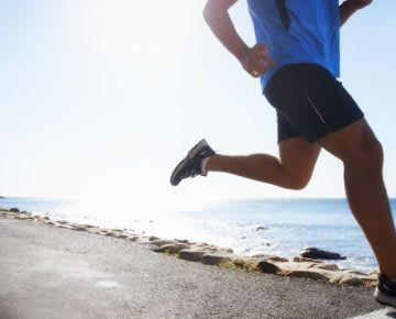 man running by the sea reasons why you are falling short with health and business goals