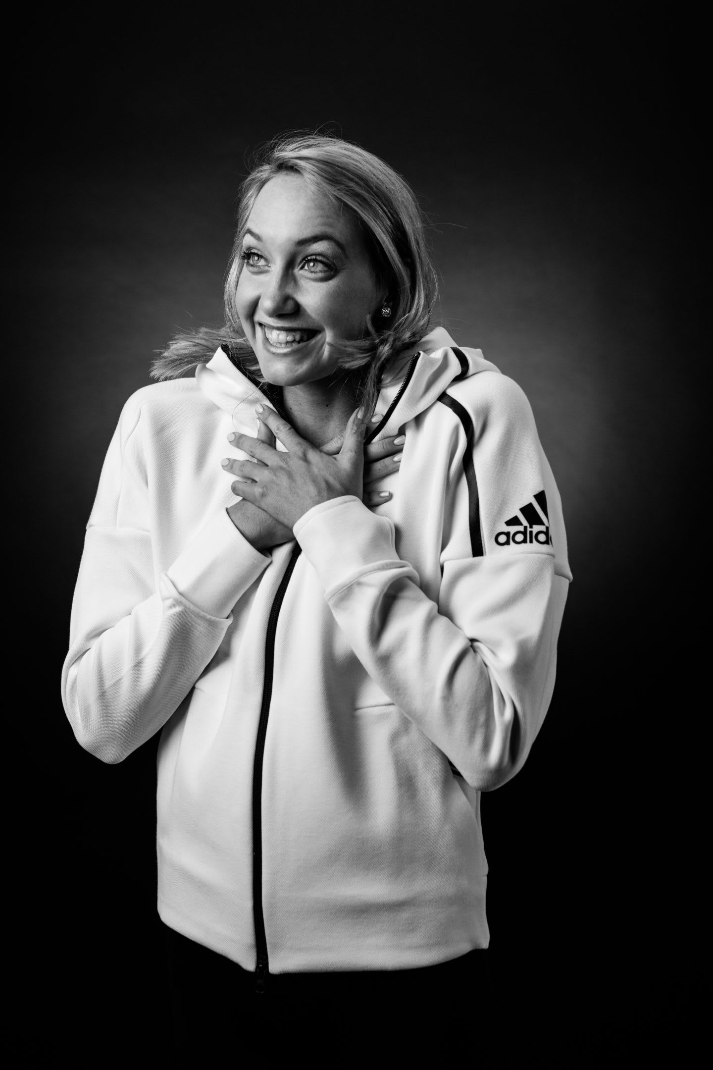 woman in white hoodie happy smiling aussie swimmer madison wilson talks voluntary work time management handling pressure