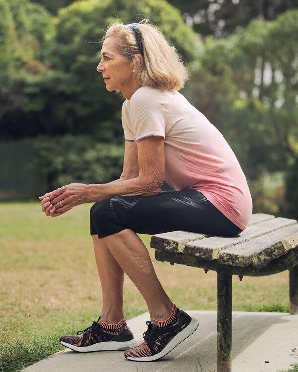 Kathrine Switzer sitting in adidas clothes