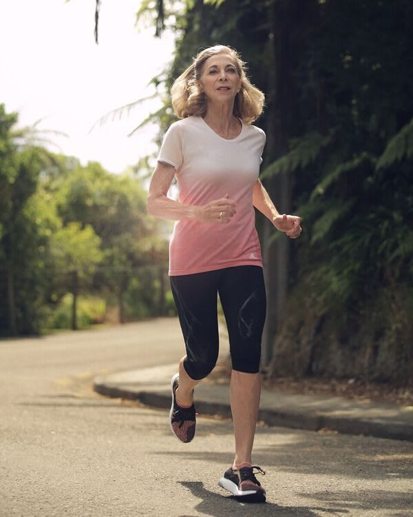 Kathrine Switzer running in adidas clothes