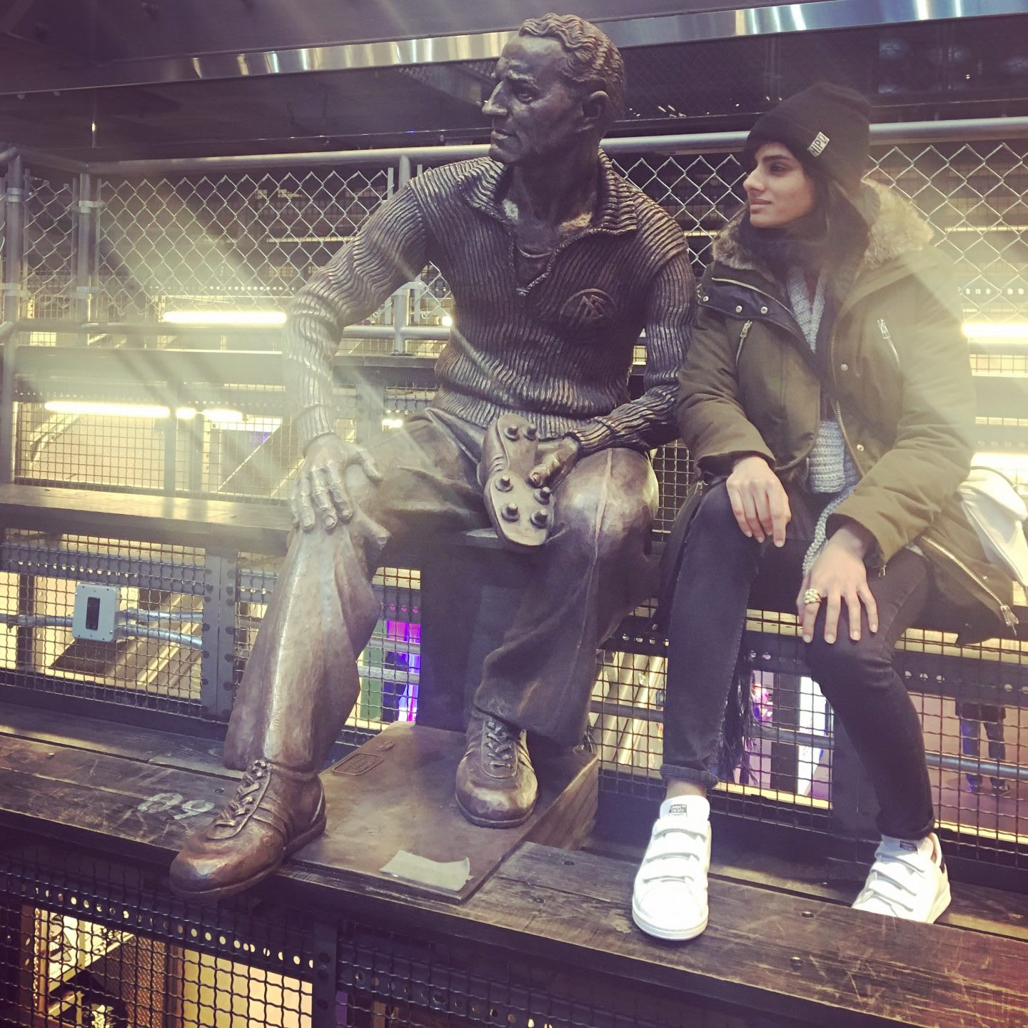 woman posing with Adi Dassler in New York City flagship store adidas talent carousel