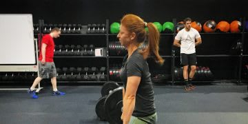 woman lifting weights in the gym friday night workout