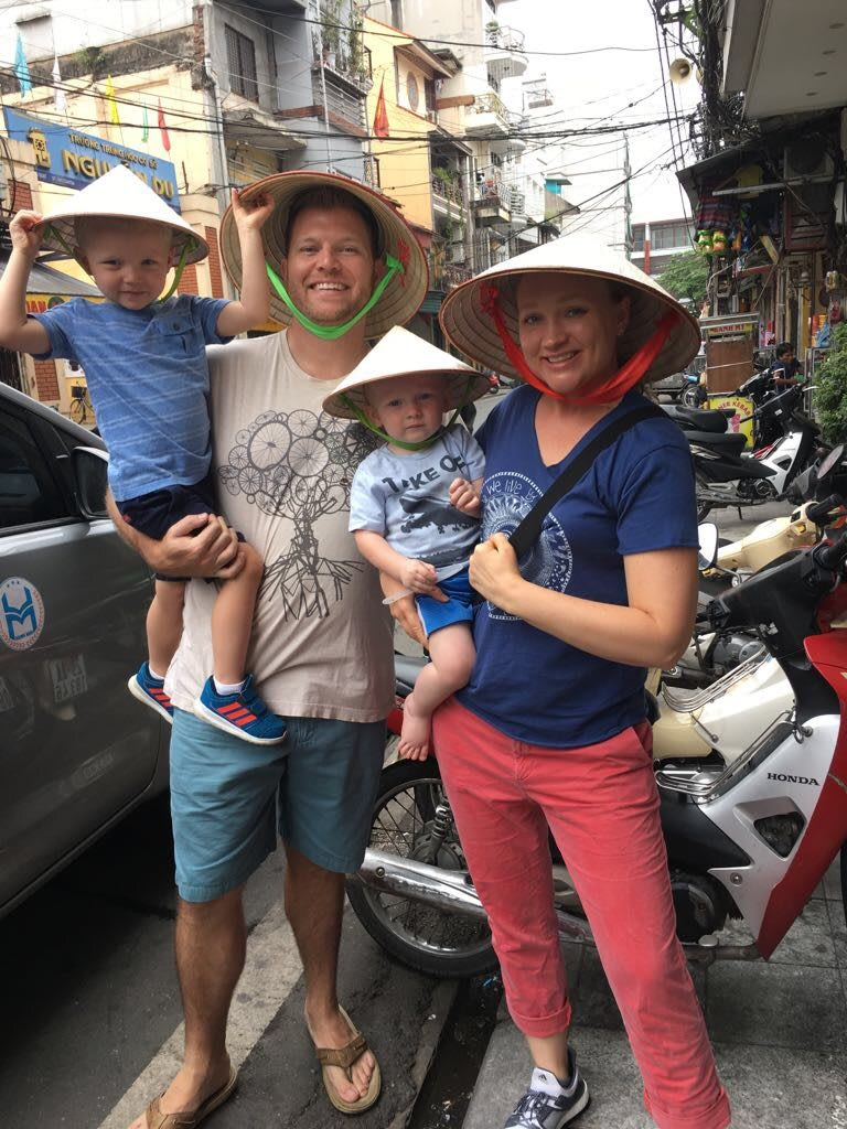 Family in Asia two boys hats smiling