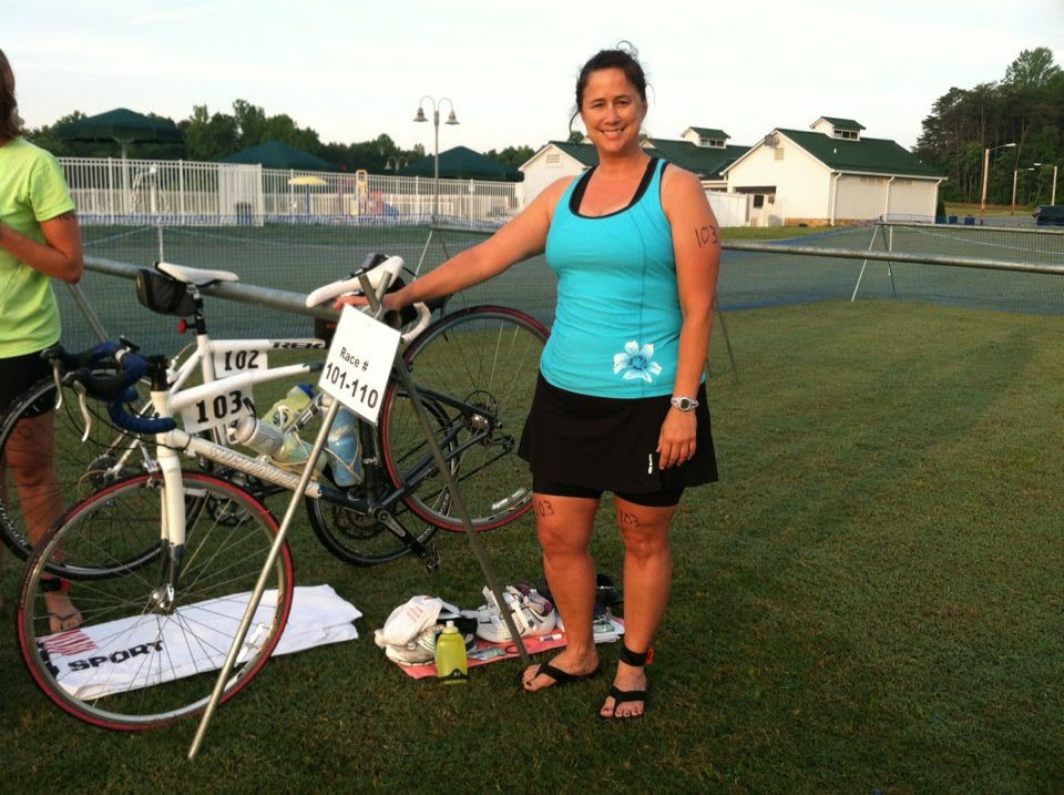 woman posing with bike falling-in-love-with-sport-Laura-Phelps-adidas-Gameplan A-bike-triathlon