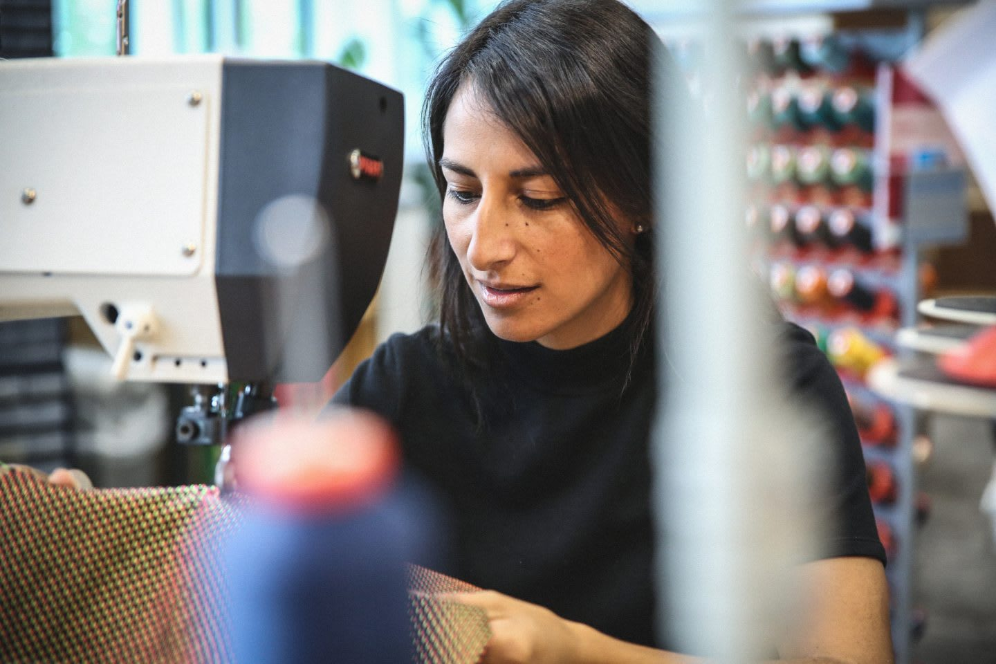 Woman working with sewing machine, designer; adidas-Makerlab-creativity-employees-creators-Maria-Fernandezi-Senior-Project-Manager-Strategy-IT-sewing-machine