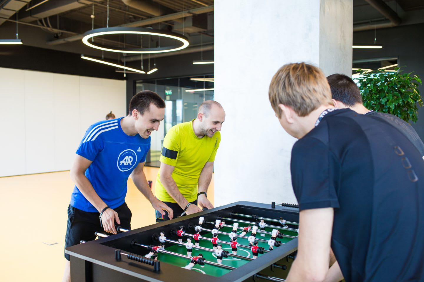 keep-your-emotional-health-in-shape-adidas-Russia-employees-bonding-playing-table-soccer