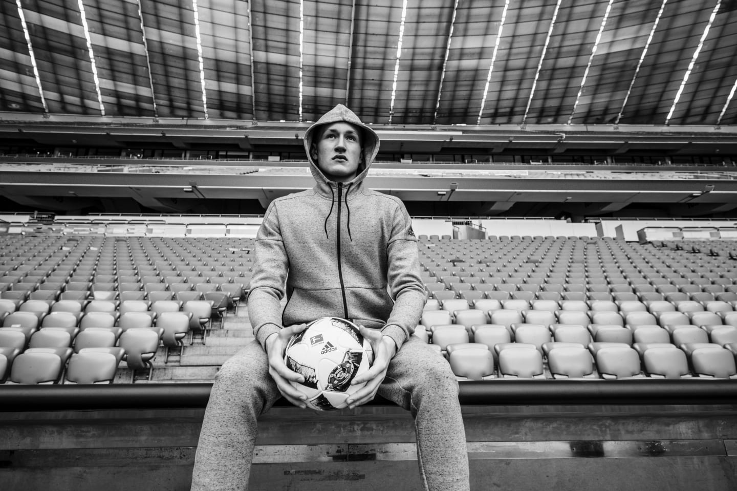 athlete-in-empty-arena-holding-ball-focusing-the-how-of-mental-strength