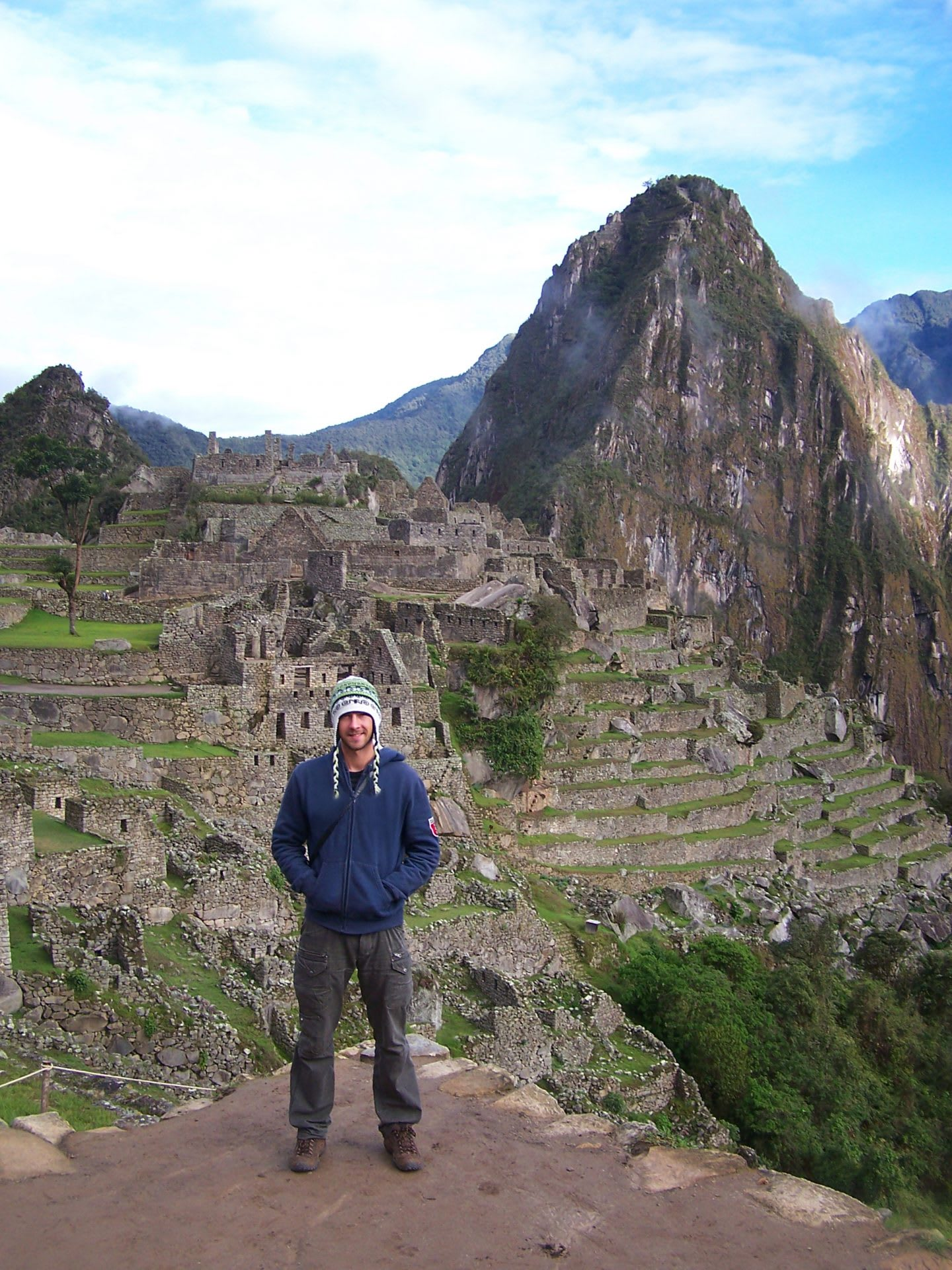 Tourist standing in front of Machu Picchu