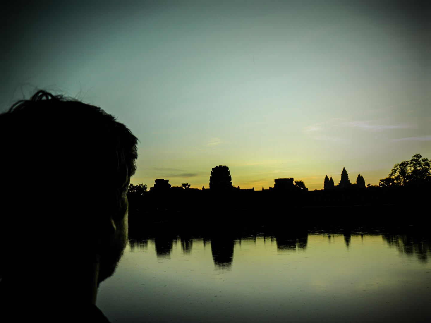 Guy watching the sunset in Angkor Wat