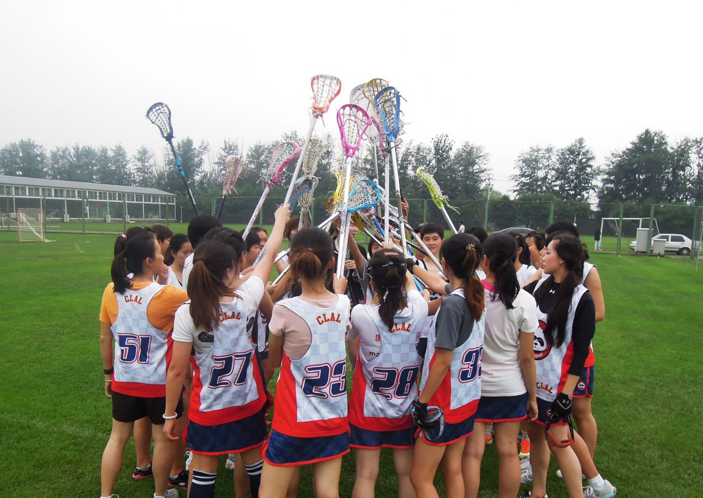 women lacrosse team standing together team spirit