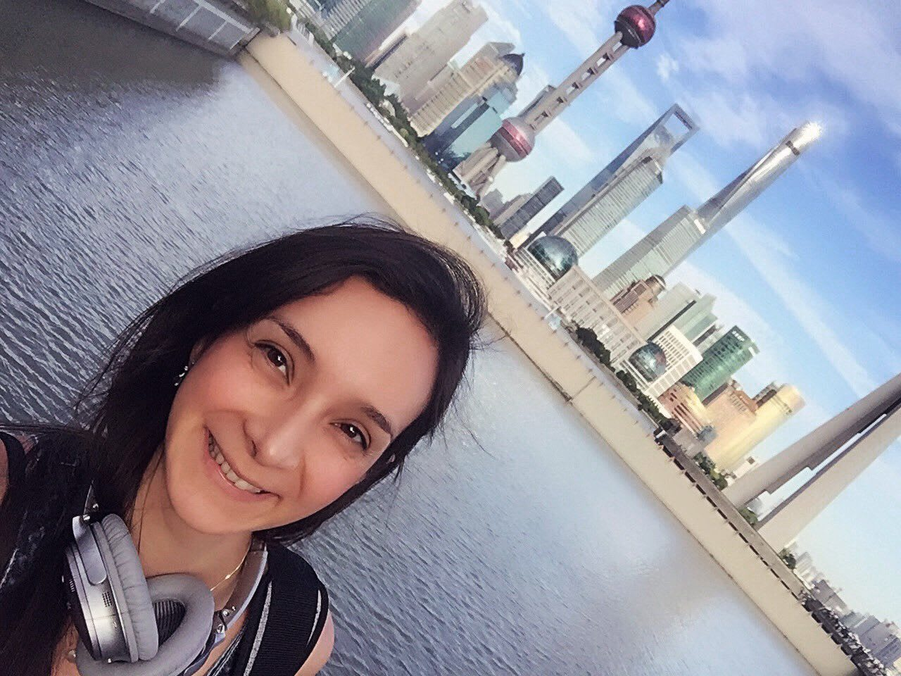 woman selfie in front of shanghai skyline trainee ditching stereotypes