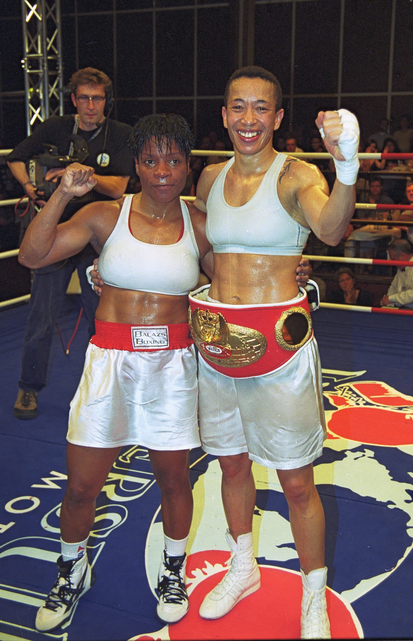 Michele-Aboro-vs-Brown-after-fight-celebration-championship-belt-smiling