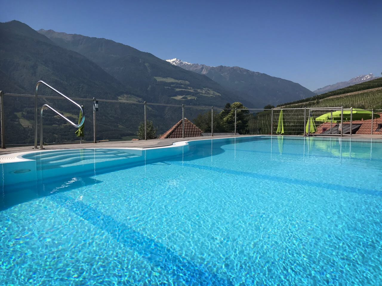 pool with mountain view active holidays relaxing unwinding