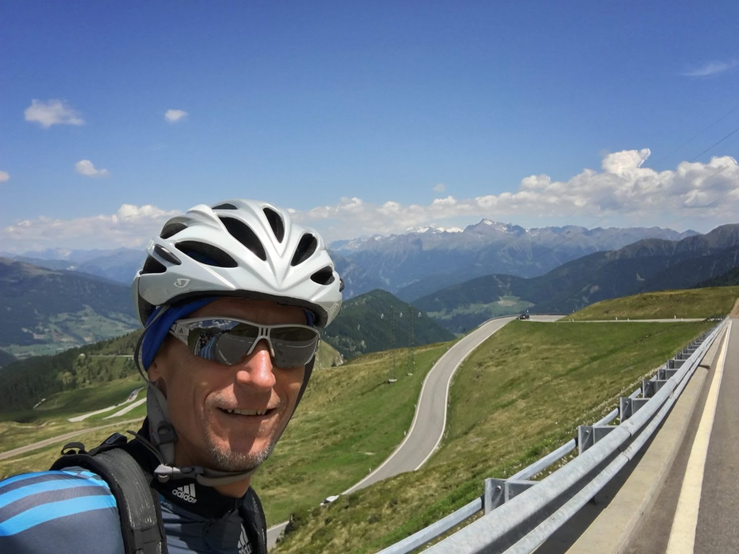 cyclist selfie mountain top road active holidays to unwind