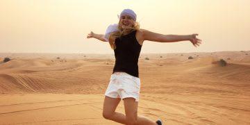 desert-girl-jumping-happy-sunset