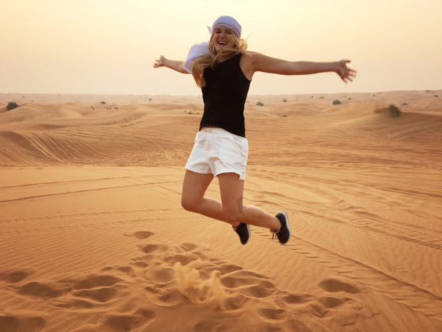 desert-girl-jumping-happy-sunset