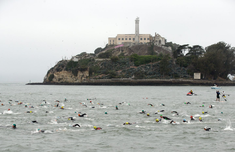 Escape from Alcatraz Triathlon_Island in the background_Swimmers in the Sea
