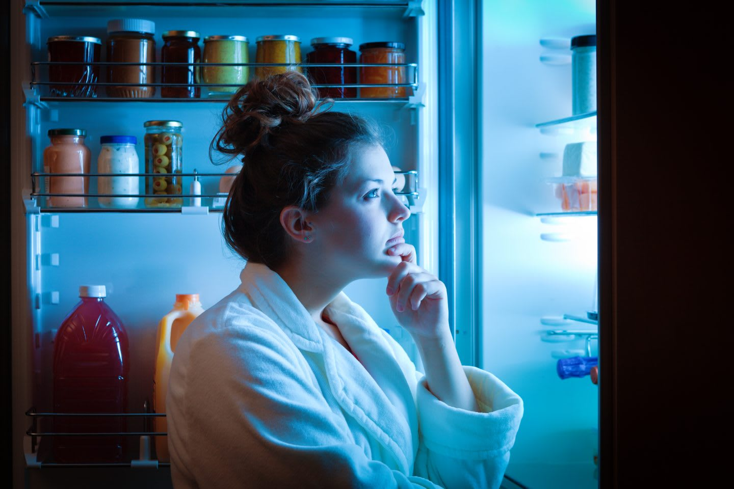 A young dieting woman standing in front of the refrigerator, contemplating and thinking about what to eat for hunger. Making choices and decision for healthy lifestyle, adidas, GamePlan A, nutrition, health