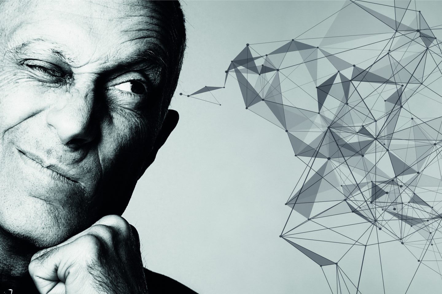 Black and white image of man with one eye closed focused and thinking with an abstract doodle drawn to illustrate his creative thoughts.