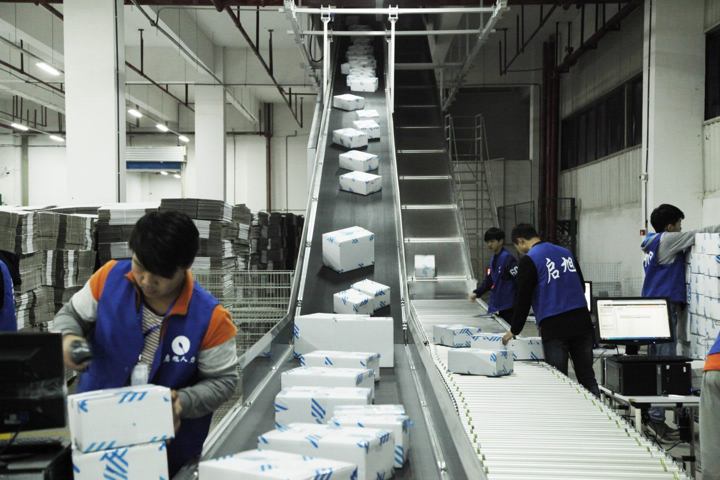 Working in Chinese Factory on a belt where packages are ready for distribution