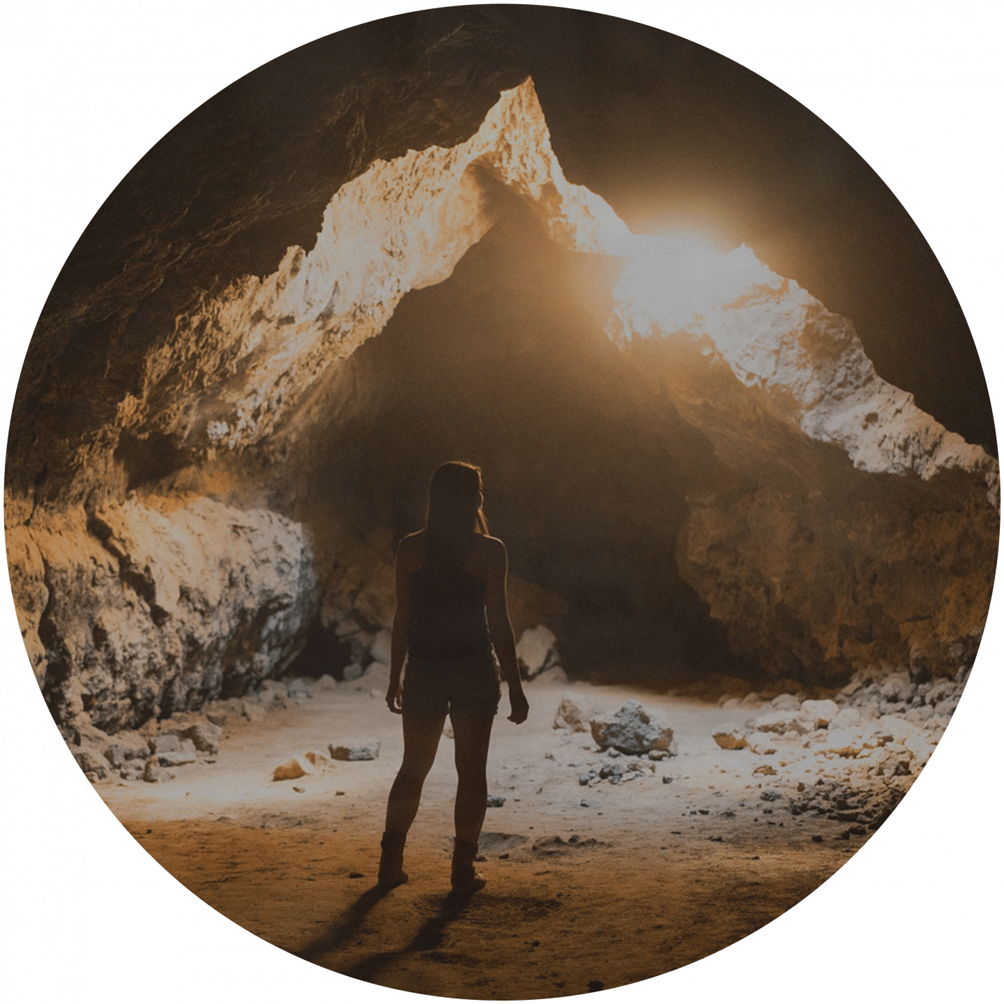 A woman is standing in front of a cave entrance. team building, cave, explorer, exploration, team event, outdoor, adventure, adidas, GamePlan A, team bonding