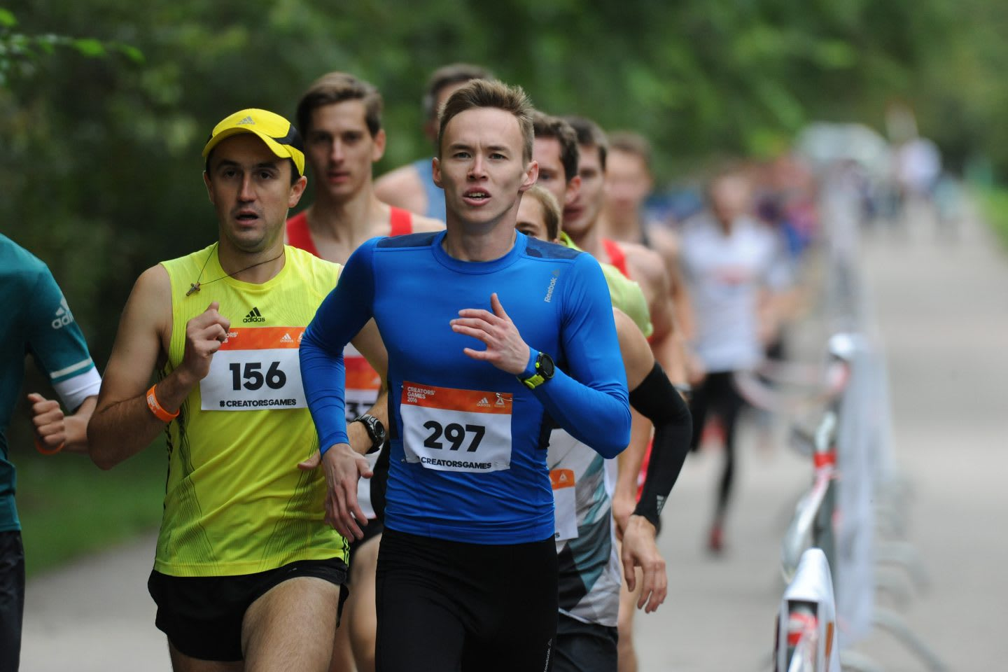 A man is pictured running in a race with other runners following him. Running; Race; Competiton; Motivation; Athlete