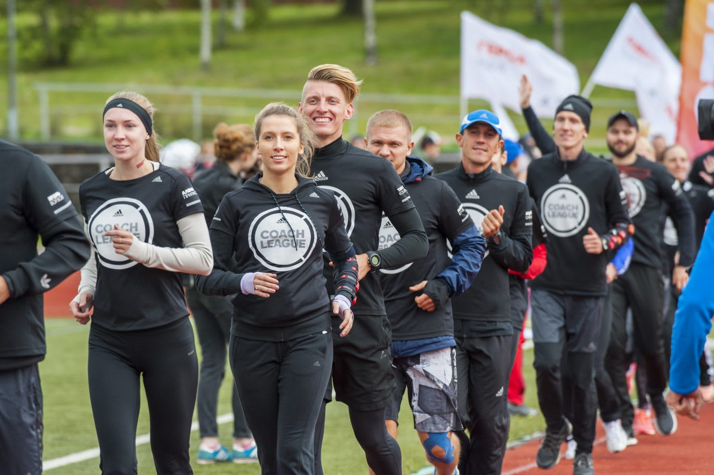A group of people in the same outfit are running together behind each other. Running: Team; Workout; Motivation; Creators' Games
