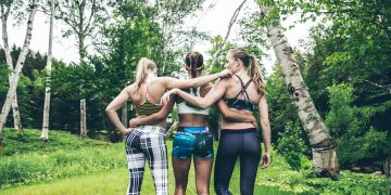 three women in sportswear walking in the forest why you are your own best mentor