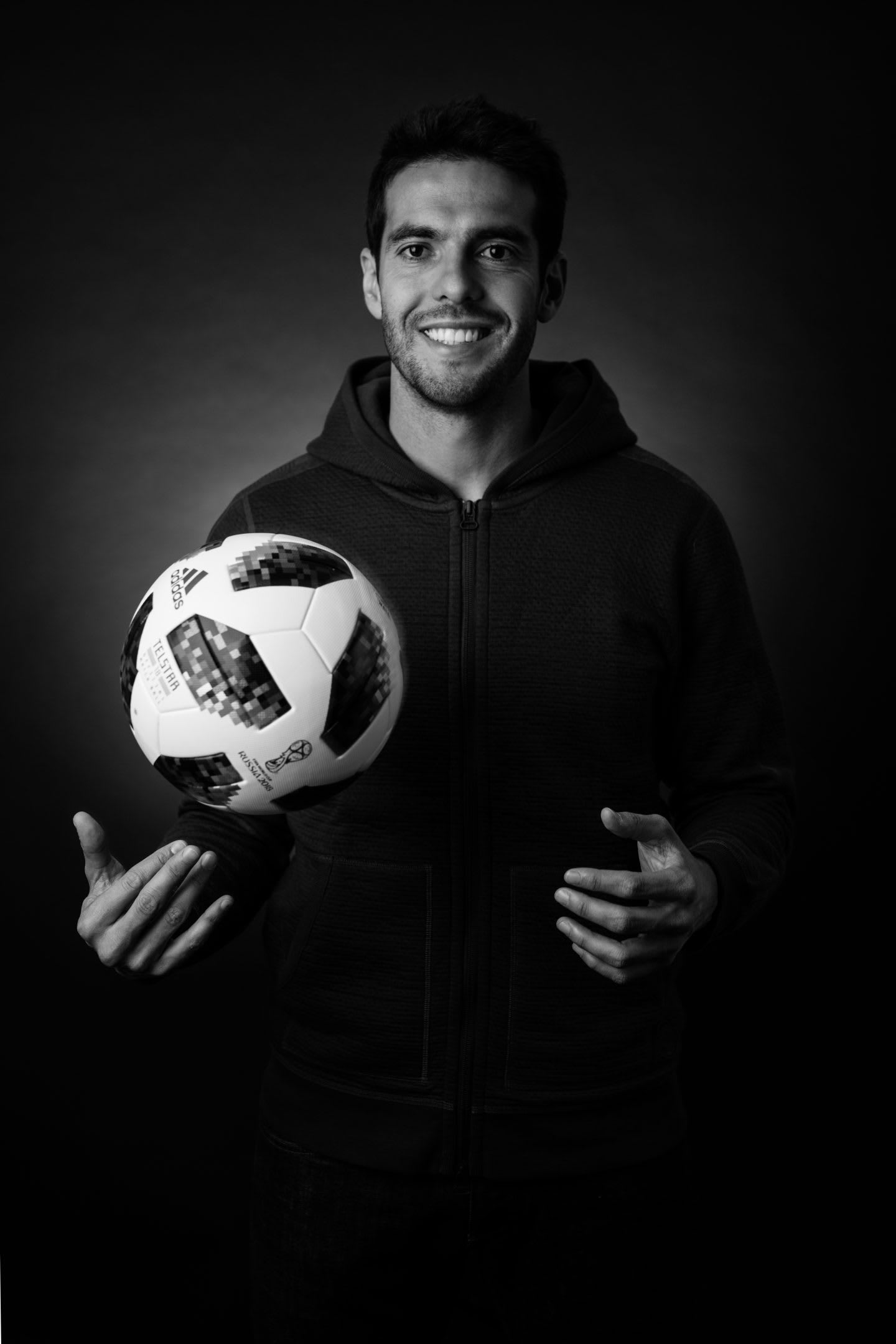 Black and white picture of Kaka smiling in the camera and holding an adidas match ball, adidas, GamePlan A, interview, game day, feeling, motivation, mindset, attitude, interview, positivity, leadership, captain, team