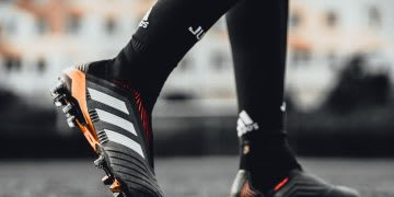 The feet of a person wearing the 2017 Predator football boots are shown. adidas; predator; legend; icon; Football; soccer; boot; champion