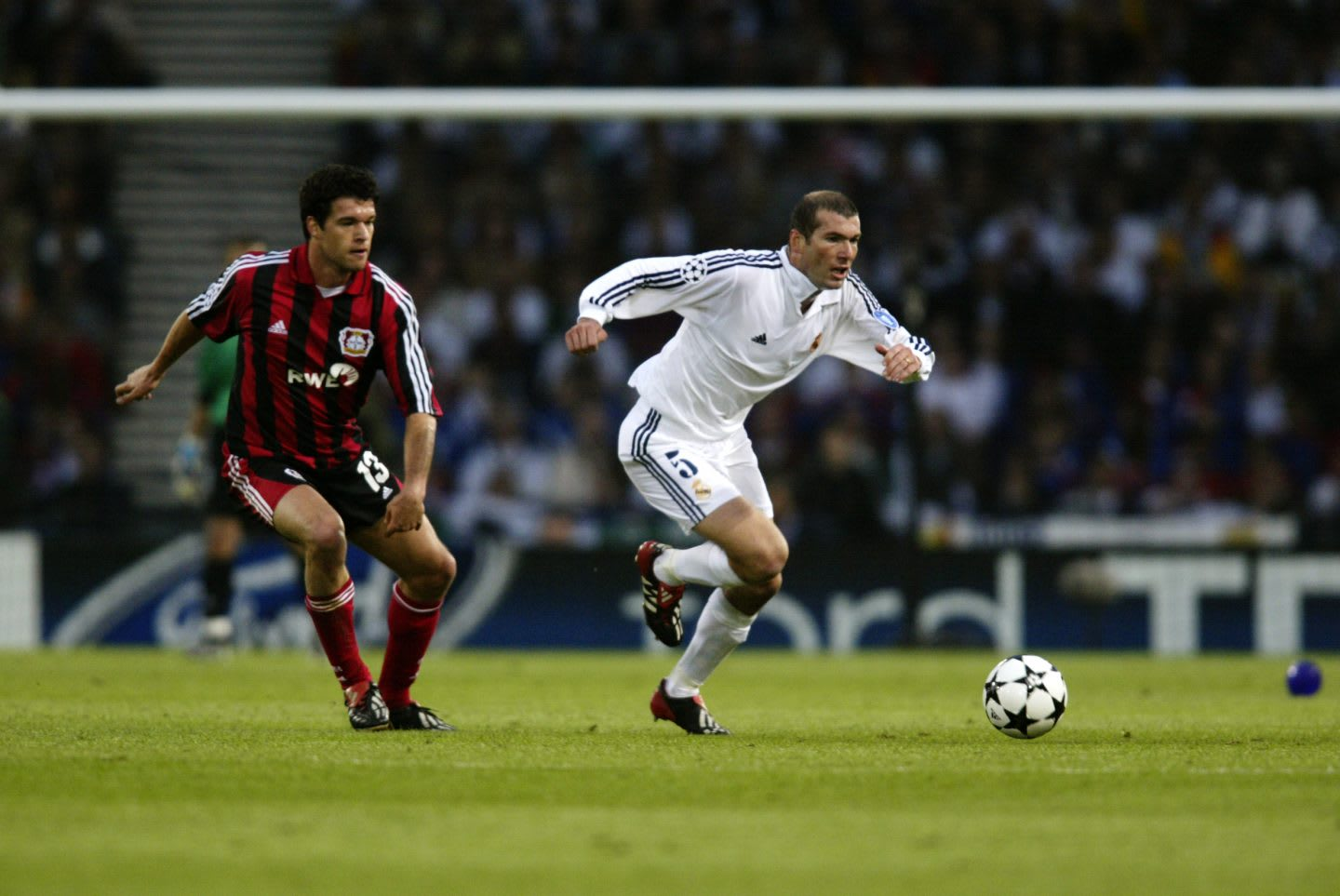 Real Madrid's Zinedine Zidane is playing the foorball while Leverkusen's Michael Ballack is trying to stop him in the Champions League Final 2002, both are wearing Predator boots. adidas; Predator; Champions League; fight; win; Icon; Legend; Final; Zidane