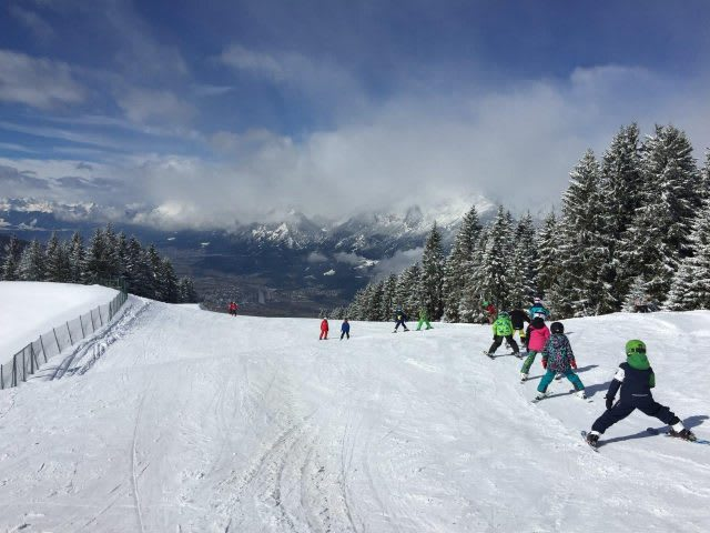 Kids are learning how to ski down a mountain