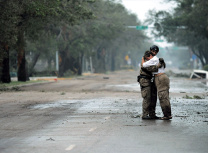 A US Air Force rescue officer comforts a householder after Hurricane Ike tore through Texas in 2008 (US Air Force/Public domain)